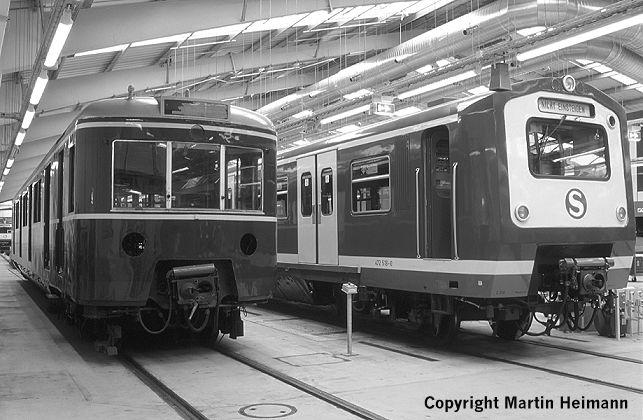 """""""Alt und gemütlich"""" neben """"schnittig und modern"""": Triebkopf 471 482 neben dem modernisierten Triebzug 472 218 in der neuen Fahrzeughalle Ohlsdorf."""